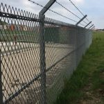 Mesh Panel Fencing Topped With Barbed Wire