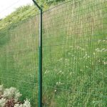 Green Mesh Panel Fencing Topped With Barbed Wire
