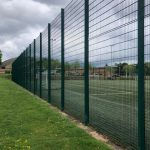 Green Ball Stop Fencing Enclosing Football Field