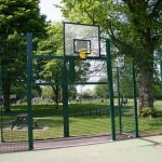 Basketball Hoop Attached To Green Steel Play Area