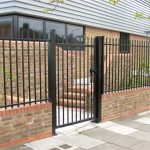 Black Steel Railings on Wall With Gate