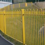 Bowed Yellow Railings For Walkway